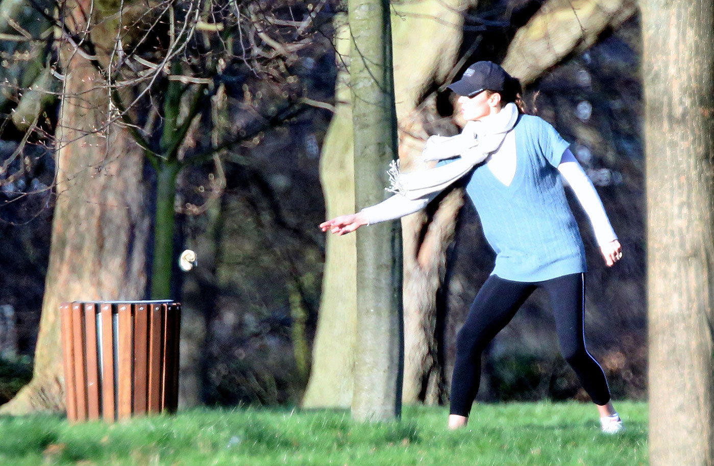 PREMIUM EXCLUSIVE: A DO-GOOD PRINCESS! Catherine, Duchess of Cambridge stops to pick up some trash and throw it away as she takes a stroll with baby George in a London park