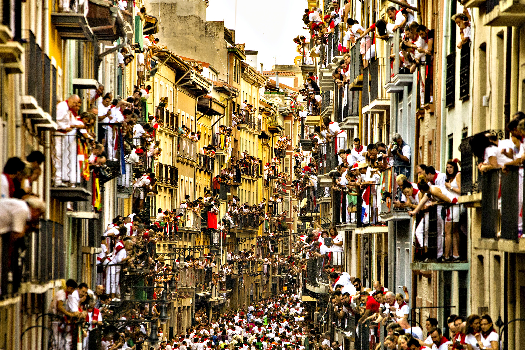 People watch as Jandilla fighting bulls and revelers run during