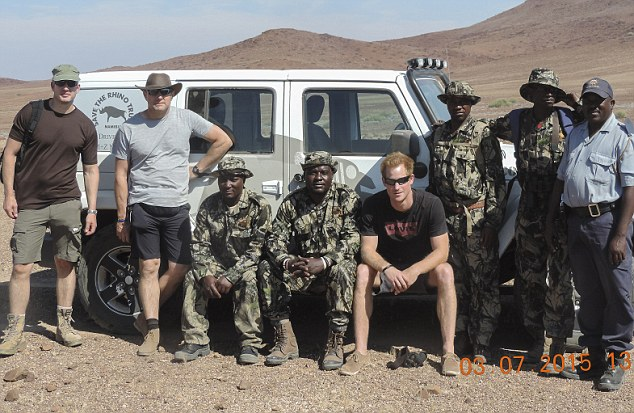 DESERT RHINO CAMP, NAMIBIA. 5 JULY 2015 Prince Harry (centre right) with the team he spent 5 days with in the North West of Namibia tracking Rhino and Lions. He is the guy in camo sitting next to Harry. Harry's right PICTURE: SIMSON URI-KHOP